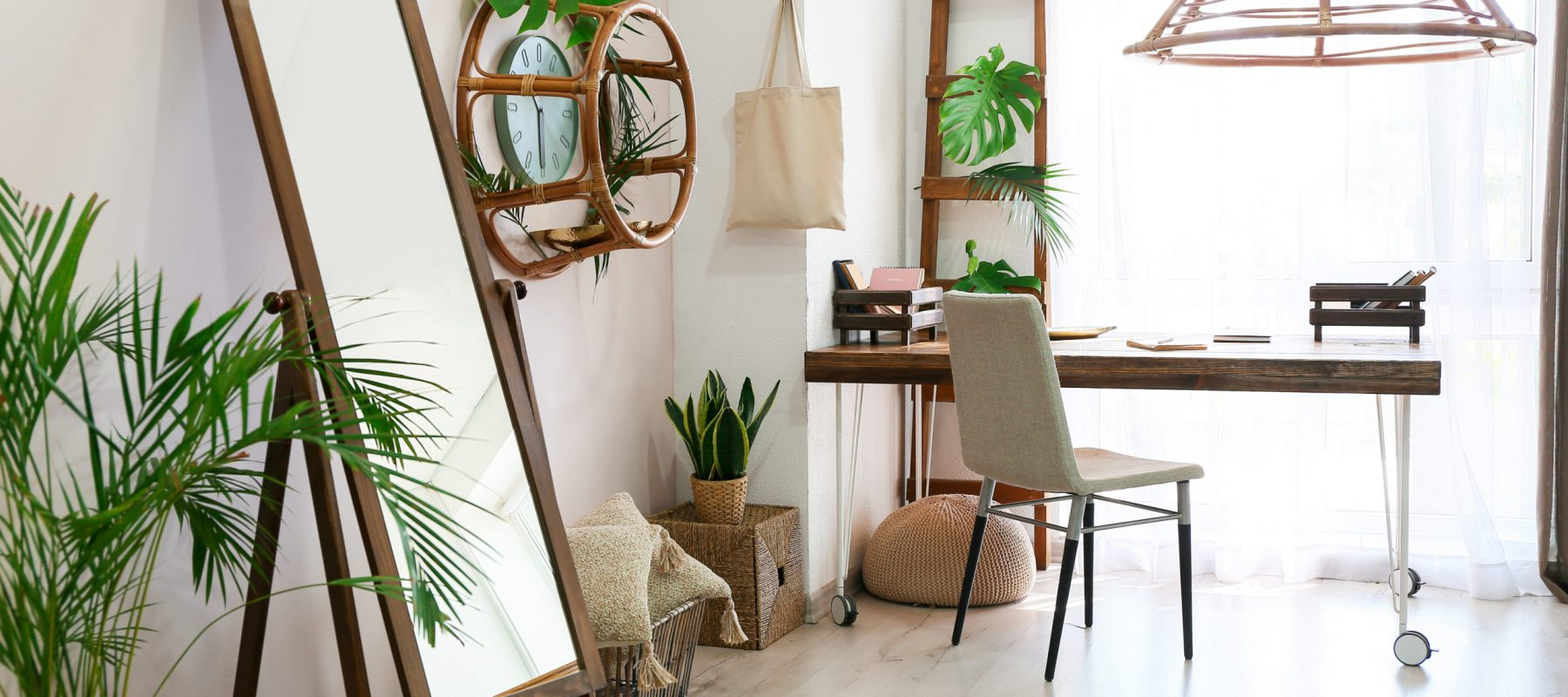 Interior of beautiful comfortable living room with big mirror, table and houseplant